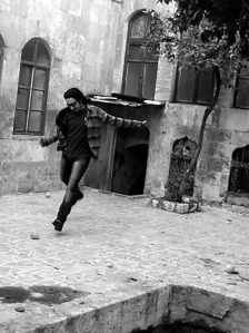 Man kicking an orange in a courtyard